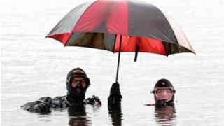 John Greener and Naomi Fisher from the Kendal and Lakes Sub-Aqua Club with umbrella