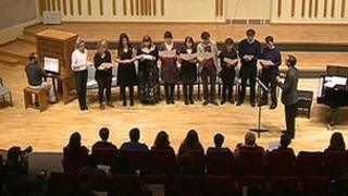 An ensemble of music students perform a Beethoven hymn