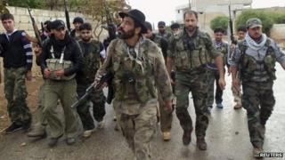 Free Syrian Army fighters in Binsh near Idlib (image filed 25 October 2012)