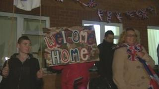Soldiers from the Royal Military Police being welcomed home
