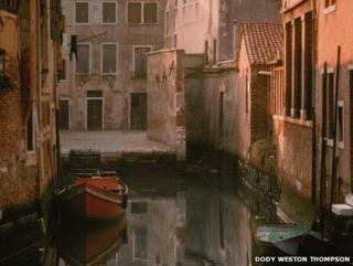 Venezia Canal with 'Eros', in Venice, Italy by Dody Weston Thompson