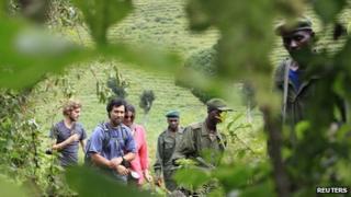 Virunga National Park rangers and tourists