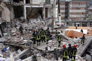 Rescue workers in collapsed building