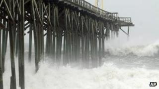 Waves pound Carolina Beach pier in Carolina Beach, N.C., Saturday, Oct 27,