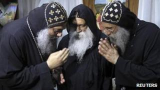 Papal candidates Fr Pachomius (L), Fr Raphael (C) and Fr Seraphim (R) talk in Cairo, 22 October 2012