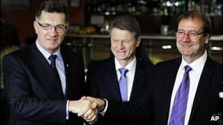 Lithuania's Social Democrat party leader Algirdas Butkevicius, left, Order and Justice party leader Rolandas Paksas, centre, and Viktor Uspaskich, right, leader of the Labour Party