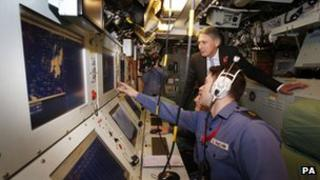 Defence Secretary Philip Hammond during a visit to HMS Victorious