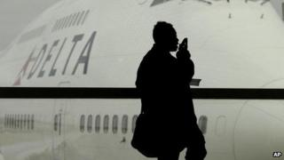 A passenger waiting for a Delta Airlines flight in Detroit.