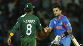 Indian batsmen Virat Kohli (right) shakes hands with Pakistan's captain Mohammad Hafeez after beating them by eight wickets in the ICC Twenty20 Cricket World Cup Super Eight match between India and Pakistan in Colombo