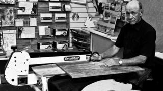 Dave Evans at his jigsaw cutting machine in his Weymouth workshop
