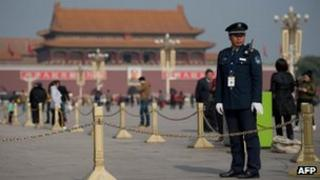 A security guard stands on Tiananmen Square in Beijing, 29 Oct 2012