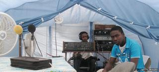 Staff of a local radio station broadcasting from a tent in quake-hit city of Jacmel
