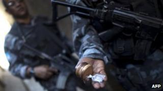 A Brazilian policeman from the Action Battalion (BAC) shows what the sniffer dog found at the Jacarezinho shantytown in Rio de Janeiro on October 16
