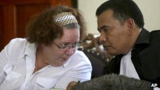 Lindsay Sandiford talks to her Indonesian lawyer Ersa Karo Karo in court during her trial in Denpasar, Bali, Indonesia