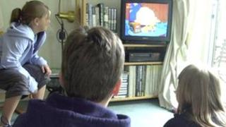 Children watching TV (generic)