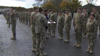 Major General PD Jones presents medals to soldiers from The Royal Anglian Regiment.