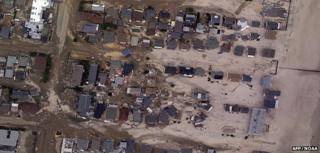 Satellite image of damaged properties (Image: AFP/NOAA)