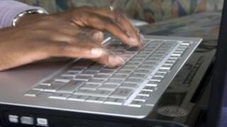 Woman uses computer (file image)