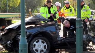 Police examine wreckage