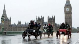 Competitors in pre-1905 cars make their way over Westminster Bridge, London