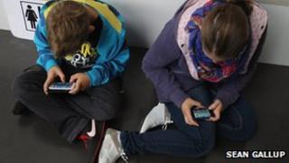 Children playing games on smartphones