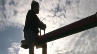 Silhouette of William Chapple on a seesaw
