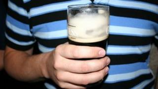 Man holding a pint