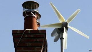 Wind turbine on roof of house