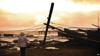 A woman surveys the damage near her home in Atlantic City, New Jersery