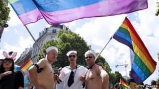 People parade during the 12th edition of Gay Pride in Paris