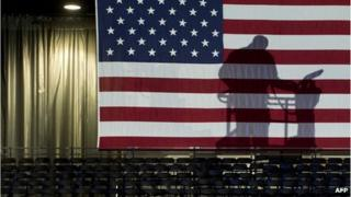 Workers complete the final details on US President Barack Obama's election night event at McCormick Place in Chicago, Illinois