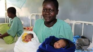 Millicent Owuor carries her twins (7 November)