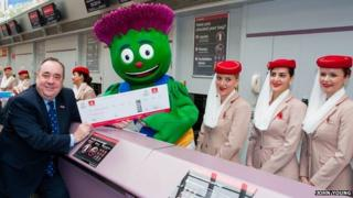 Alex Salmond with Games Mascot Clyde at the Emirates desk at Glasgow Airport