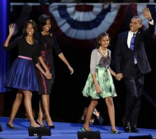President Barack Obama waves as he walks on stage with first lady Michelle Obama and daughters Malia and Sasha at his election night party in Chicago