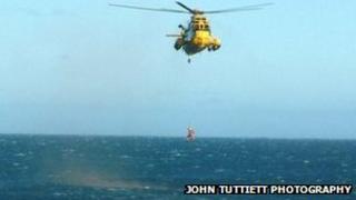RAF winchman being lowered into sea