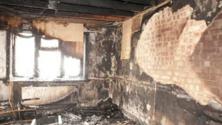 The lounge of the Shakoor family home after the fire