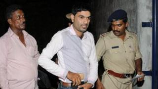 Naveen Soorinje being arrested
