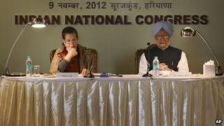 """Congress party president Sonia Gandhi, left, with Indian Prime Minister Manmohan Singh at """"Samvad Baithak"""" or Dialogue Meeting with Congress top leaders in Surajkund on the outskirts of New Delhi, India, Friday, Nov. 9, 2012."""