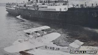 A seaplane and mail ship at St Peter Port Harbour in the 1930s