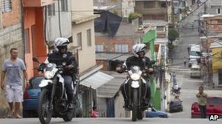 Motorcycle policemen patrol the Paraisopolis slum in Sao Paulo, Brazil, on 2/11/12