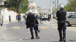 Bahraini police confront anti-government protesters in Diraz, west of Manama, on 9/11/12