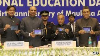 Indian president Shri Pranab Mukherjee (fourth from right) holds the new Aakash version 2.0 tablet