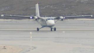 Plane landing at Barra