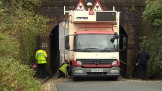 Lorry stuck under Plymouth rail bridge