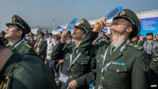 Officers of China's People Liberation Army (PLA) watch planes performing during the 9th China International Aviation and Aerospace Exhibition in Zhuhai, 13 November 2012