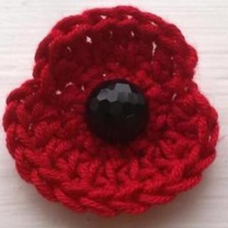 Handmade crocheted Remembrance poppy brooch