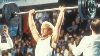 Brian Jacks weightlifting in an episode of Superstars from 1980