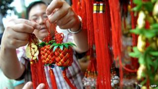 A man selling Chinese charms in Philippines