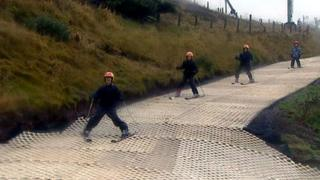 Skiers on Hillend dry ski slope