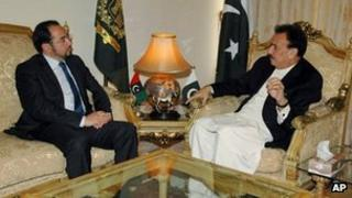 Pakistan's Interior Minister Rehman Malik, right, meets Salahuddin Rabbani, the head of Afghanistan High Peace Council in Islamabad, Pakistan, 14 November 2012